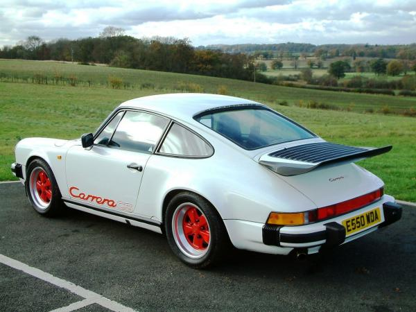 White 1988 Porsche 911 Carrera CS, seen from behind