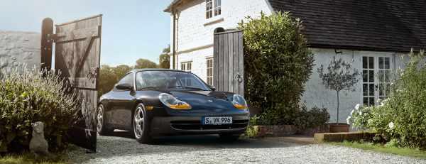 Black Porsche 996 seen from the front.