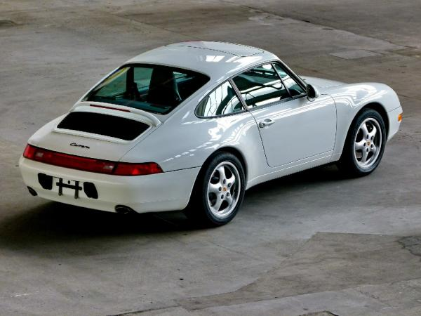 White 1995 911 Carrera 2, seen from the rear